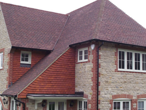 Lifestiles - Handcrafted Orange Clay Roof Tiles - Seaford College, England